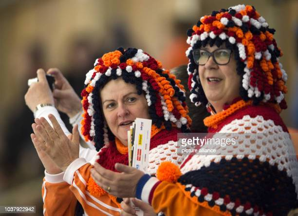 Dutch fans wearing costumes made from knitting wool cheer for their athletes at the ISU World Allround Speed Skating Championships in Berlin,...