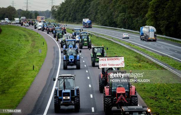 Dutch farmers protest with their tractors on their way to the the provincial government office of Drenthe in Assen, on October 14, 2019. - The...