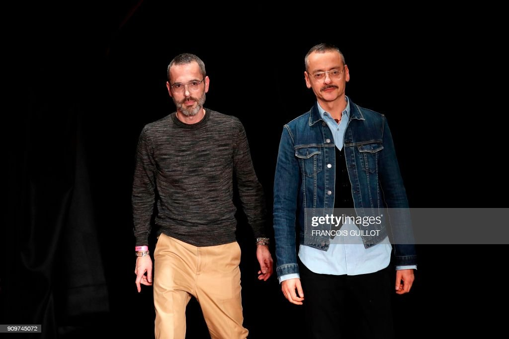 Dutch fashion designers Rolf Snoeren and Viktor Horsting for Viktor and Rolf acknowledge the audience at the end of the 2018 spring/summer Haute Couture collection fashion show on January 24, 2018 in Paris. /