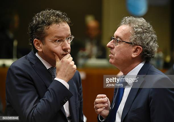 Dutch Finance Minister and Eurogroup president Jeroen Dijsselbloem listens to Luxembourg's Finance Minister Pierre Gramegna during an Economic and...