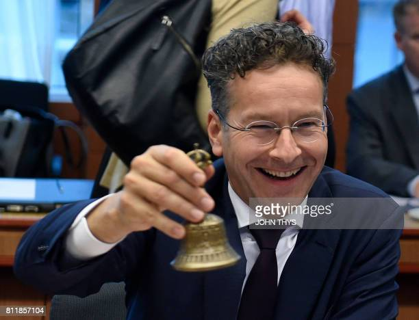 Dutch Finance Minister and Eurogroup president Jeroen Dijsselbloem rings the bell during a Eurogroup meeting on July 10 2017 at the European Union...
