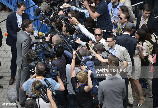 Dutch Finance Minister and president of Eurogroup Jeroen Dijsselbloem speaks to journalists as he arrives for a Eurogroup meeting ahead of a Eurozone...