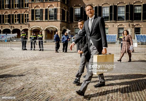Dutch Finance Minister Jeroen Dijsselbloem holding a special case with an inscription reading 'Third Tuesday of September' arrives to the Binnenhof...
