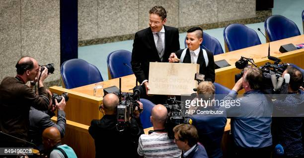 Dutch Finance Minister Jeroen Dijsselbloem presents a special case with an inscription reading 'Third Tuesday of September' in the second chamber of...