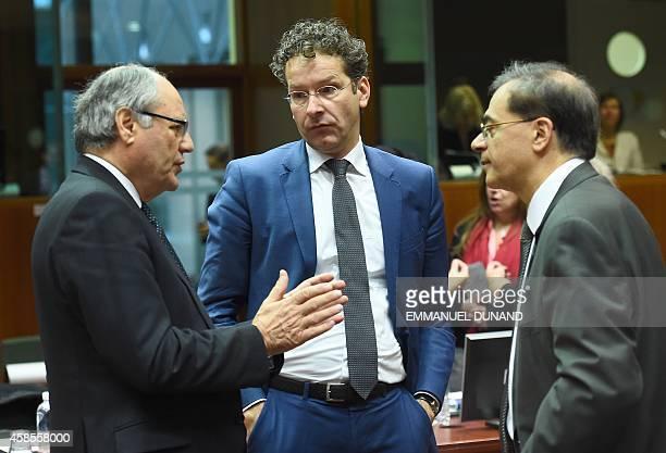 Dutch Finance Minister Jeroen Dijsselbloem speaks with Maltese Finance Minister Edward Scicluna and Greece's Finance Minister Gikas Hardouvelis at...
