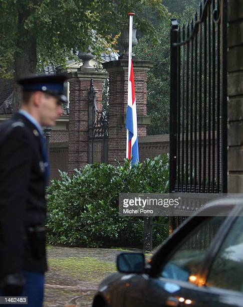 Dutch flag hangs half mast at the gate of the royal Huis ten Bosch Palace after Prince Claus of the Netherlands husband to Dutch Queen Beatrix had...