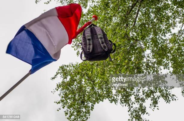dutch flag with bag because of passed exams - flagga bildbanksfoton och bilder