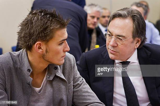 Dutch foootballer Bas Dost talks with his lawyer Cor Hellingman in the headquarters of the Dutch football association in Zeist on January 31, 2011...