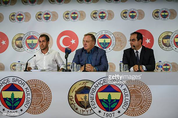 Dutch football coach Dick Advocaat sits next to Fenebahce's vicepresident Sekip Mosturoglu during the signing ceremony of his new contract with...