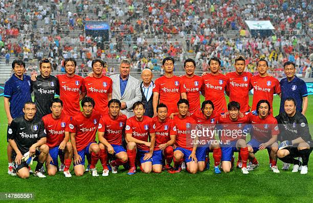 Dutch football coach Guus Hiddink who led the South Korean national team to a fourth place finish in the 2002 FIFA World Cup poses with his 2002...