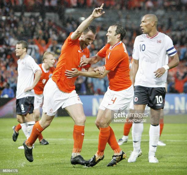 Dutch football player Andre Ooijer celebrates his 1-0 together with team mate Joris Mathijsen in the World Cup 2010 qualifying football match between...