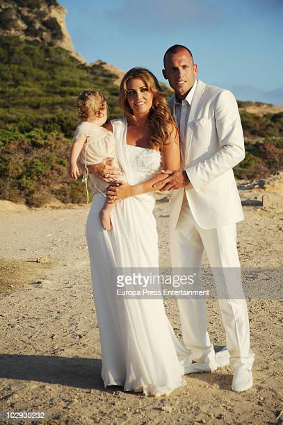 Dutch football player John Heitinga Charlotte Sophie Zenden and their daughter Jezabel pose at their wedding on July 15 2010 in Ibiza Spain