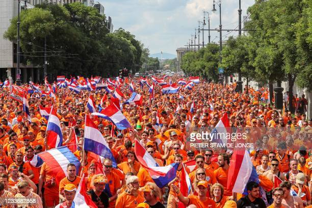 Dutch football supporters walk to the Ferenc Puskas Arena, as the Dutch team plays in the last sixteen Euro 2020 football match against the Czech...