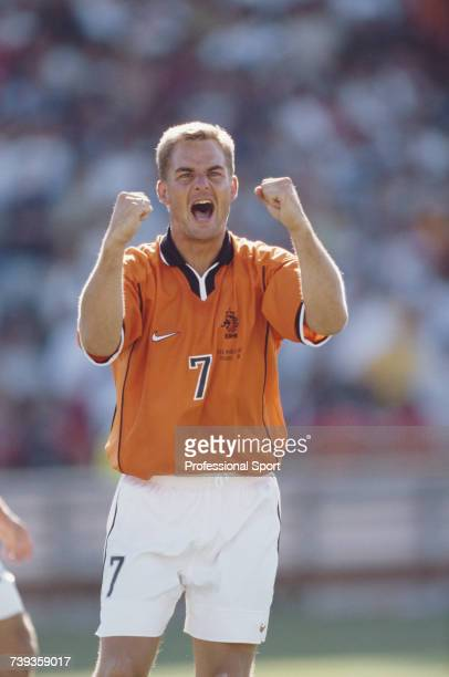 Dutch footballer and defender with the Netherlands national football team Frank de Boer pictured celebrating during a Netherlands game at the 1998...