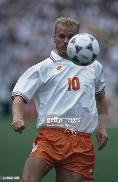 Dutch footballer Dennis Bergkamp pictured with the ball during play in the 1994 FIFA World Cup quarter-final match between Netherlands and Brazil at...