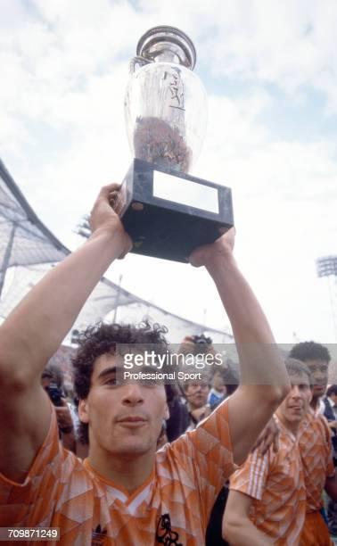 Dutch footballer Gerald Vanenburg raises the UEFA European Championship trophy in the air in celebration after Netherlands beat the Soviet Union 20...