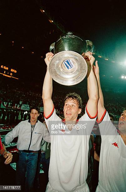 Dutch footballer Marco van Basten of AC Milan with the trophy after his team beat Benfica 10 in the European Cup Final at the Praterstadion Vienna...