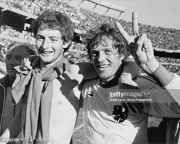 Dutch footballers Ernie Brandts and Arie Haan celebrate after beating Italy 21 in their World Cup Second Round Group A match at Estadio Monumental...