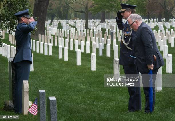 Dutch Foreign Minister Frans Timmermans pays his respects at the gravesites of Dutch servicemen killed in the line of duty April 30 placing flowers...