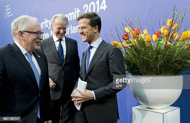 Dutch Foreign Minister Frans Timmermans, The Hague mayor Jozias van Aartsen and Dutch Prime Minister Mark Rutte leave at the end of a joint press...