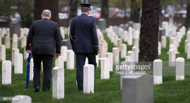 Dutch Foreign Minister Frans Timmermans walks with Netherlands Defense Attache Air Corp Reefman as they pay respects at the gravesites of Dutch...