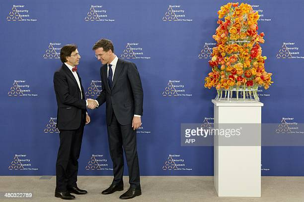 Dutch Foreign Minister Mark Rutte greets Belgian Prime Minister Elio Di Rupo upon his arrival at The World Forum in The Hague on March 24 2014 on the...