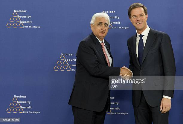 Dutch Foreign Minister Mark Rutte greets Indian Foreign Minister Salman Khurshid upon his arrival at The World Forum in The Hague on March 24 2014 on...