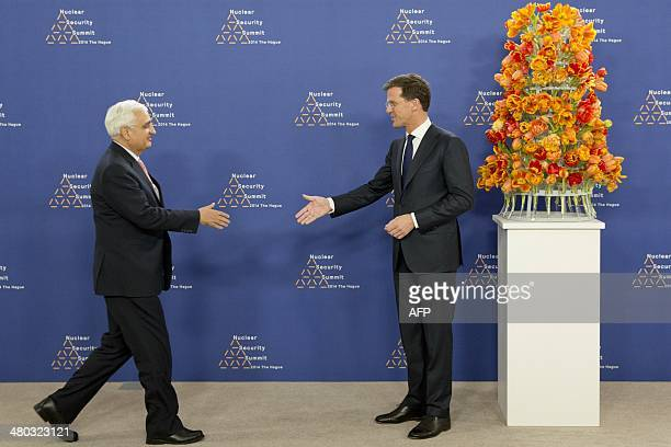 Dutch Foreign Minister Mark Rutte greets Indian Foreign Minister Salman Khurshid upon his arrival at The World Forum in The Hague on March 24, 2014...