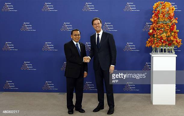 Dutch Foreign Minister Mark Rutte greets Indonesian Vice President Boediono upon his arrival at The World Forum in The Hague on March 24, 2014 on the...
