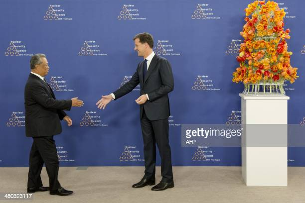 Dutch Foreign Minister Mark Rutte greets Malaysian deputy Prime Minister Muhyiddin Yassin upon his arrival at The World Forum in The Hague on March...