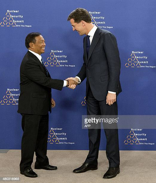 Dutch Foreign Minister Mark Rutte greets Philippines' Vice President Jejomar Binay upon his arrival at The World Forum in The Hague on March 24, 2014...