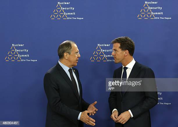 Dutch Foreign Minister Mark Rutte greets Russian Foreign Minister Sergei Lavrov upon his arrival at The World Forum in The Hague on March 24 2014 on...