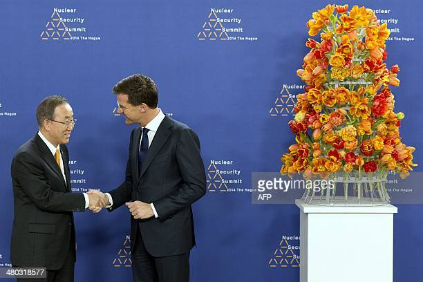 Dutch Foreign Minister Mark Rutte greets UN secretary general Ban Ki-moon upon his arrival at The World Forum in The Hague on March 24, 2014 on the...