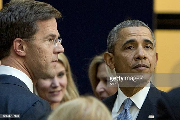 Dutch Foreign Minister Mark Rutte greets US President Barack Obama at The World Forum in The Hague on March 24, 2014 on the first day of the two-day...