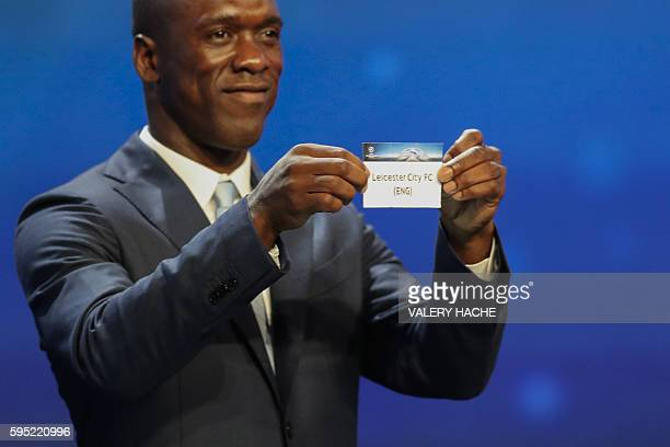 Dutch former football player Clarence Seedorf shows a piece of paper bearing the name of Leicester City FC during the UEFA Champions League Group...