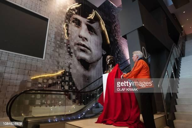 Dutch former football player Wim Suurbier unveils the bust of late Dutch football player and coach Johan Cruyff displayed at the Johan Cruyff ArenA...