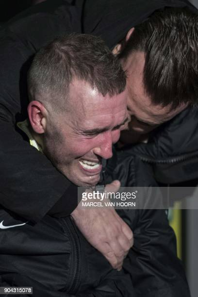 Dutch former professional footballer Fernando Ricksen who played as a right back and right midfielder reacts during the unveiling of a bust in his...