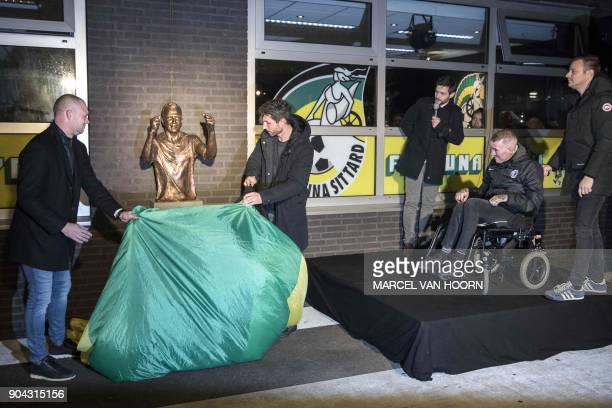 Dutch former professional footballer Fernando Ricksen who played as a right back and right midfielder looks on during the unveiling of a bust in his...