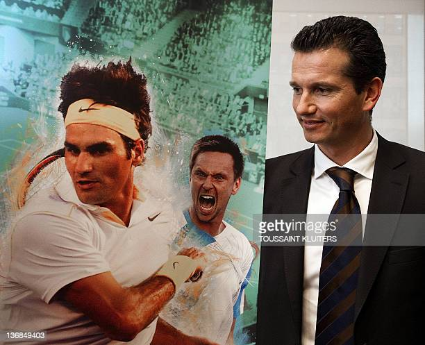 Dutch former tennis player Richard Krajicek CEO of the ABN AMRO World Tennis Tournament stands by a poster featuring photographs of Swiss players...