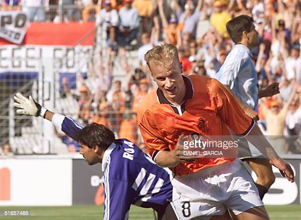 Dutch forward Dennis Bergkamp bursts in joy after he scored the victory goal against Carlos Roa in their 1998 Soccer World Cup quarter final match 04...