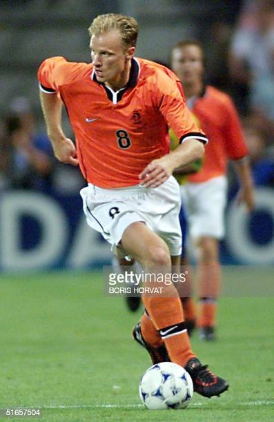 Dutch forward Dennis Bergkamp looks sideways as he dribbles the ball during the 1998 Soccer World Cup semifinal match between Brazil and the...
