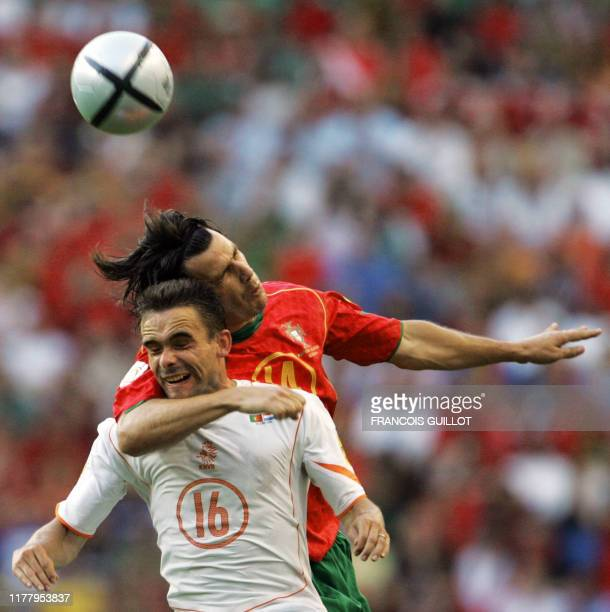 Dutch forward Marc Overmars and Portuguese defender Nuno Valente head the ball 30 June 2004 at the Alvalade stadium in Lisbon during the Euro2004...