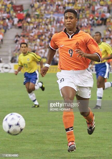 Dutch forward Patrick Kluivert chases the ball during the 1998 Soccer World Cup semi-final match between Brazil and the Netherlands, 07 July at the...