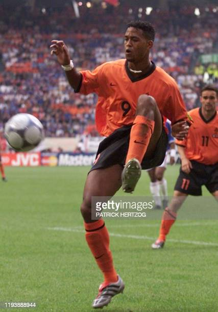Dutch forward Patrick Kluivert kicks the ball during the Euro-2000 Group D first round match between France and The Netherlands, 21 June 2000 at the...