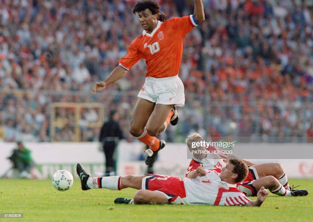 Dutch forward Ruud Gullit jumps over the attempted : News Photo