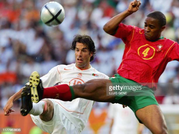 Dutch forward Ruud Van Nistelrooy and Portuguese defender Jorge Andrade stretch for the ball, 30 June 2004 at the Alvalade stadium in Lisbon, during...
