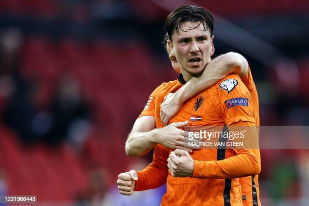 Dutch forward Steven Berghuis celebrates the 1-0 during their World Cup qualifying Group G match between the Netherlands and Latvia at the Johan...