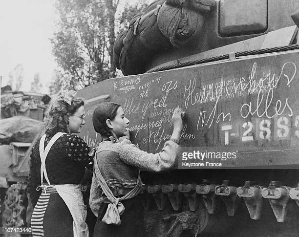 Dutch Girls Writing Welcome Slogans On A Polish Tank In Holland On September 1944