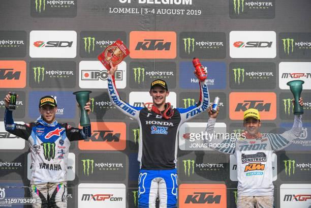 Dutch Glenn Coldenhoff, Slovenian Tim Gajser and French Romain Febvre celebrate on the podium after the MXGP race at the GP Limburg motocross event...
