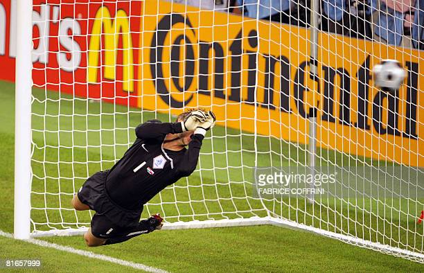 Dutch goalkeeper Edwin van der Sar dives for the ball during the Euro 2008 Championships quarterfinal football match the Netherlands vs Russia on...